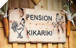 THEMENBILD - Erntedankfest, Bezirkserntedankfest für den Bezirk Liezen, im Bild eine Tafel aus Holz auf einem Hühnerstall mit der Aufschrift Pension Kikariki, aufgenommen am 27.09.2015 in Haus im Ennstal, Steiermark, Österreich // a sign made of wood at harvest festival in Haus im Ennstal, Styria, Austria on 2015/09/27. EXPA Pictures © 2015, PhotoCredit: EXPA/ Martin Huber
