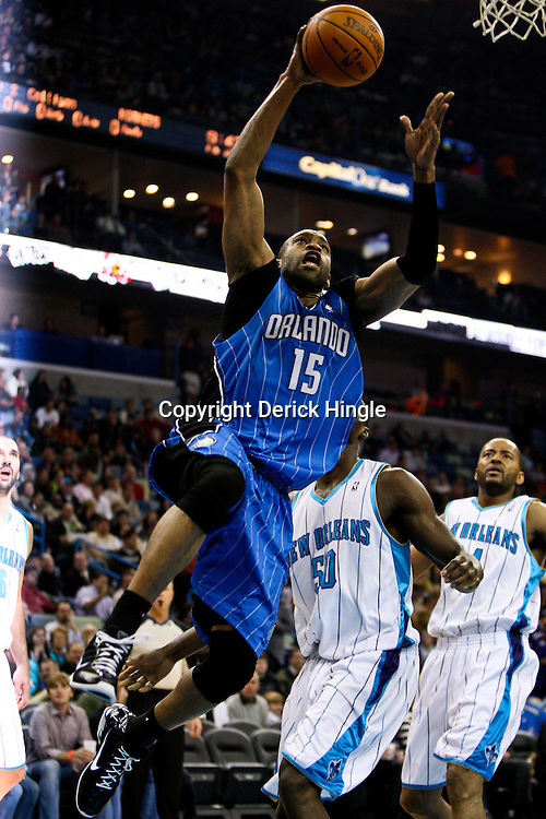 Feb 26, 2010; New Orleans, LA, USA; Orlando Magic guard Vince Carter (15) drives to the basket during the first quarter against the New Orleans Hornets at the New Orleans Arena. Mandatory Credit: Derick E. Hingle-US PRESSWIRE