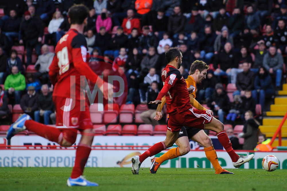 Wolves Forward Kevin Doyle (IRL) slots the ball past Bristol City Defender Liam Fontaine (ENG) to score a goal during the first half of the match - Photo mandatory by-line: Rogan Thomson/JMP - Tel: Mobile: 07966 386802 01/12/2012 - SPORT - FOOTBALL - Ashton Gate - Bristol. Bristol City v Wolverhampton Wanderers - npower Championship.