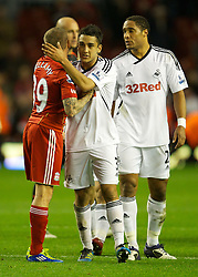 05.11.2011, Anfield Stadion, Liverpool, ENG, Premier League, FC Liverpool vs Swansea City, im Bild Liverpool's Craig Bellamy and his Wales team-mate Swansea City's Neil Taylor // during the premier league match between FC Liverpool vs Swansea City at Anfield Stadium, Liverpool, EnG on 05/11/2011. EXPA Pictures © 2011, PhotoCredit: EXPA/ Propaganda Photo/ David Rawcliff +++++ ATTENTION - OUT OF ENGLAND/GBR+++++