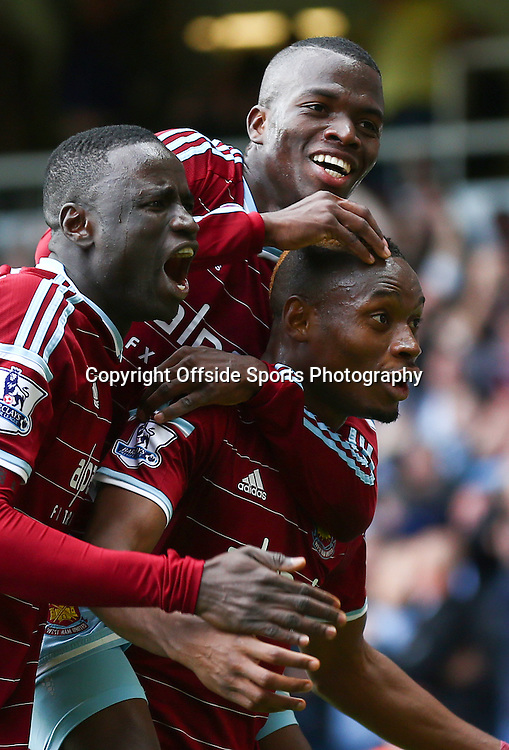 25 October 2014 - Barclays Premier League - West Ham v Manchester City - Diafra Sakho of West Ham (R) celebrates scoring the winning goal with team mates - Photo: Marc Atkins / Offside.