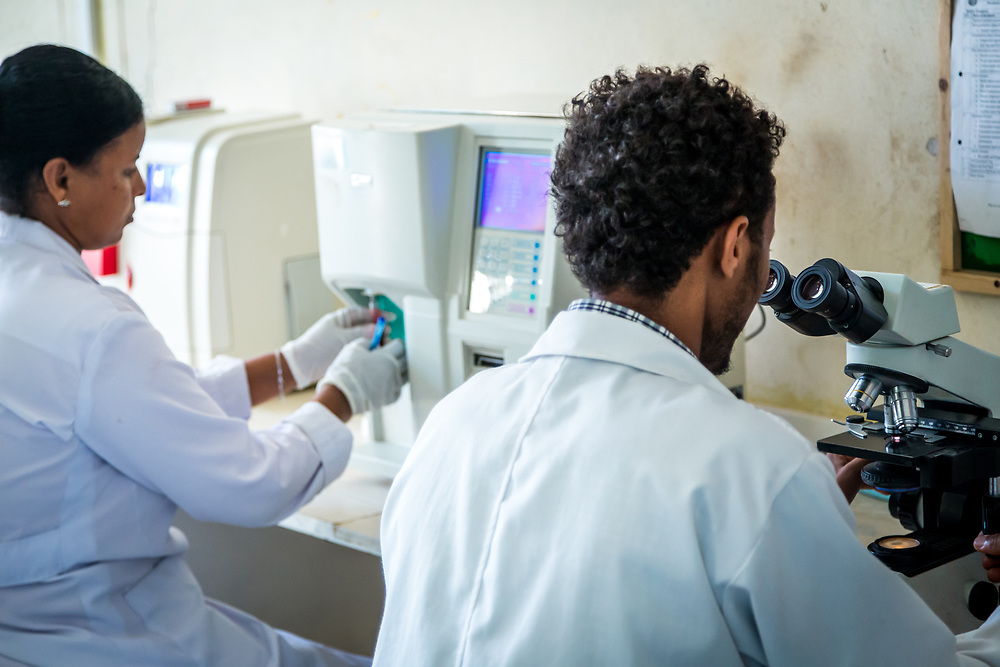 INDIVIDUAL(S) PHOTOGRAPHED: N/A. LOCATION: Felege Hiwot Referral Hospital, Bahir Dar, Ethiopia. CAPTION: Lab technicians use sophisticated microscope and blood testing technology to help doctors diagnose their patients.