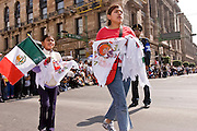 16 SEPTEMBER 2005 - MEXICO CITY:  Students hand out Mexican flags and march in the Independence Day parade in Mexico City, Sept. 16. Mexico celebrated its 195th Independence Day in 2005 with a huge military parade through the center of Mexico City.  PHOTO BY JACK KURTZ