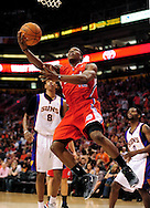 Apr. 1, 2011; Phoenix, AZ, USA; Los Angeles Clippers guard Eric Bledsoe (12) puts up a shot against the Phoenix Suns at the US Airways Center. The Suns defeated the Clippers 111-98. Mandatory Credit: Jennifer Stewart-US PRESSWIRE