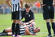 Peacehaven Ross Sutton is down injured during the Pre-Season Friendly match between Peacehaven & Telscombe and Luton Town at the Peacehaven Football Club, Peacehaven, United Kingdom on 18 July 2015. Photo by Phil Duncan.