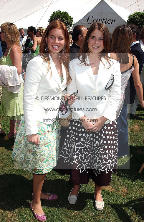 Left to right, PRINCESS BEATRICE OF YORK and PRINCESS EUGENIE OF YORK at the 2004 Cartier International polo day at Guards Polo Club, Windsor Great Park, Berkshire on 25th July 2004.