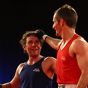 Brett Black (red) and Dave Hertog (blue) after their bout at the 'Thriller in the Chiller' charity boxing event as part of the Queenstown Winter Festival at the Queenstown Events Centre , South Island, New Zealand, 25th June 2011
