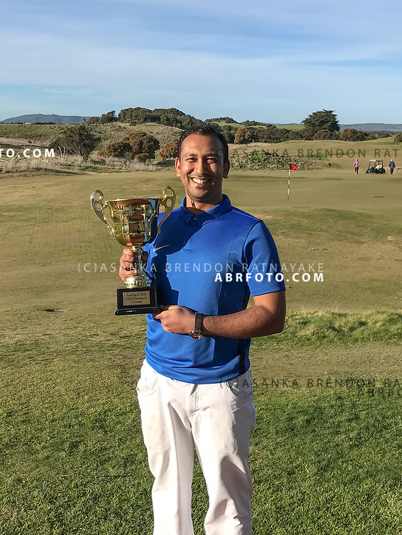 Asanka Brendon Ratnayake holds the trophy after winning the GenY Golf C-grad Club championships at the Dunes 1 july 2018