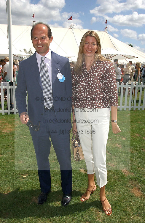 COUNT & COUNTESS RICCARDO PAVONCELLI she was Cosima Von Bulow daughter of Claus Von Bulow at the Cartier International polo at Guards Polo Club, Windsor Great Park, on 30th July 2006.<br />