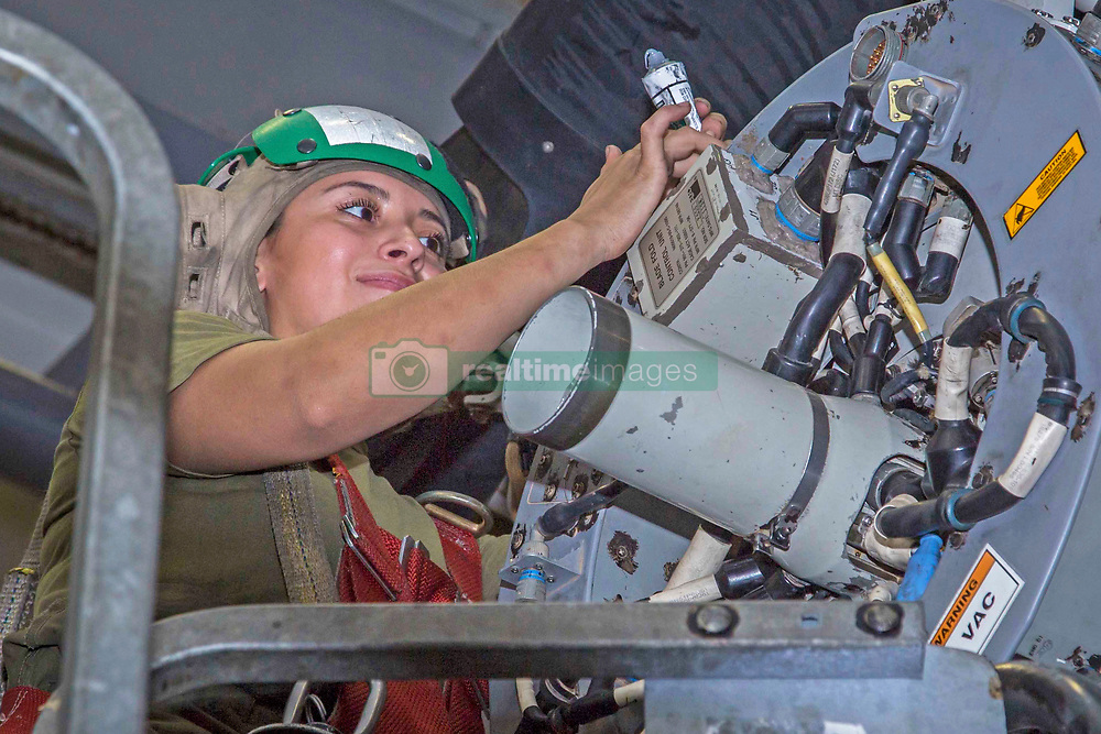 ARABIAN SEA– U.S. Marine Cpl. Yesenia Rojas, an avionics electrician with Marine Medium Tiltrotor Squadron 166 Reinforced, 13th Marine Expeditionary Unit (MEU), seals screws on an MV-22B Osprey aboard the Wasp-class amphibious assault ship USS Essex (LHD 2), Oct. 2, 2018. The Essex is the flagship for the Essex Amphibious Ready Group and, with the embarked 13th MEU, is deployed to the U.S. Fifth Fleet area of operations in support of naval operations to ensure maritime stability and security in the Central Region, connecting the Mediterranean and the Pacific through the western Indian Ocean and three strategic choke points. (U.S. Marine Corps photo by Cpl. Francisco J. Diaz Jr./Released)