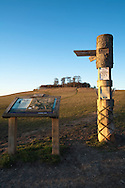 Evening light over Wittenham Clumps in the Sinodun Hills with signpost and information board, near Wallingford, Oxfordshire, Uk