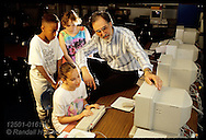 David Schlamb and three of his fifth graders work at computer; Old Bonhomme School, St. Louis. Missouri