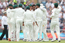 Pakistan's Hasan Ali (centre) celebrates taking the wicket of England's Alastair Cook during day one of the second Investec Test Match at Headingley Carnegie, Leeds.