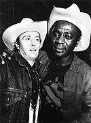 Men in cowboy hats, London, 1990s.