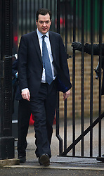 © London News Pictures. 19/03/2013 . London, UK.  British Chancellor of the Exchequer George Osbourne leaving the entrance to Downing Street. The Chancellor is due to announce the new budget tomorrow. Photo credit : Ben Cawthra/LNP