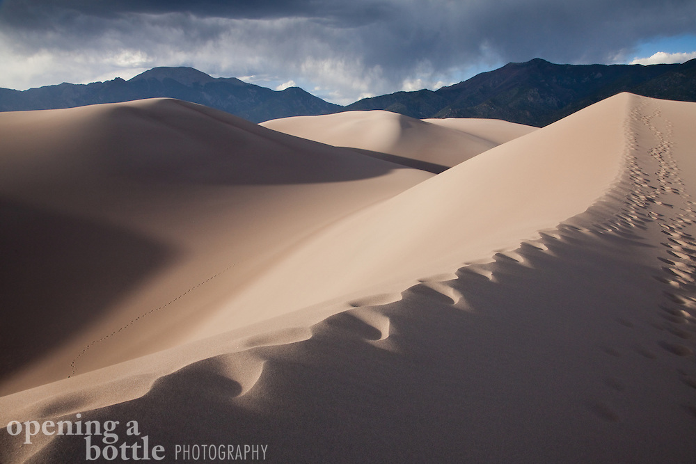 Foot prints follow a sand dune ridge, Great Sand Dunes National Park and Preserve, Colorado.