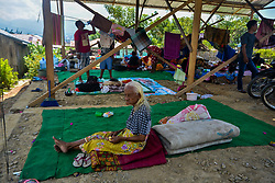 Oct. 2, 2018 - Palu, Indonesia - A woman sits inside a shelter in Balaroa village after earthquake and tsunami in Palu, Central Sulawesi, Indonesia. The death toll of Indonesia's multiple powerful quakes that triggered tsunami in Central Sulawesi province on Friday soared to 1,249 people with 799 others sustaining serious injuries, a governmental disaster official said here on Tuesday.  (Credit Image: © Iqbal Lubis/Xinhua via ZUMA Wire)