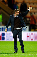 MK Dons Manager Karl Robinson celebrates victory  at the end of the Carling Cup 2nd Round match at Carrow Road Stadium, Norwich, Norfolk...Picture by Paul Chesterton/Focus Images Ltd.  07904 640267.23/8/11