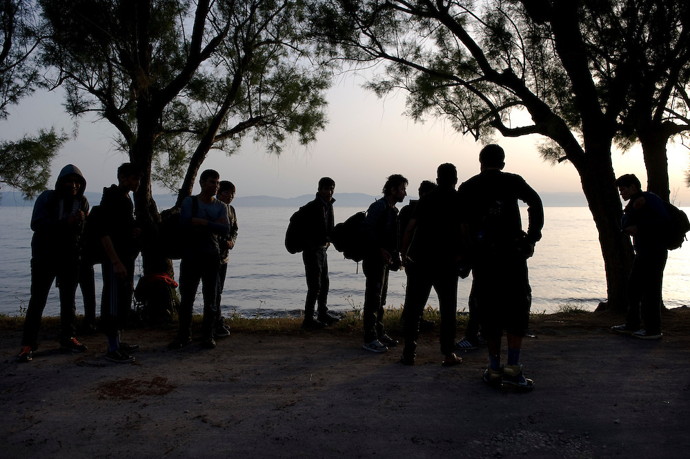 A group of Afghan refugees minutes after their boat landed on the beach of Skala Sykaminias. Everyday hundreds of refugees, mainly from Syria and Afghanistan, are crossing in small overcrowded inflatable boats the 6 mile channel from the Turkish coast to the island of Lesbos in Greece. Many spend their life savings, over $1000, to buy a space on those boats.