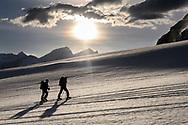 Two alpinists are climbing up on the Zmuttgletscher, Valais, Switzerland
