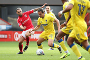 AFC Wimbledon attacker Egli Kaja (21) dribbling and battles for possession with Charlton Athletic midfielder Ricky Holmes (11) during the EFL Sky Bet League 1 match between Charlton Athletic and AFC Wimbledon at The Valley, London, England on 28 October 2017. Photo by Matthew Redman.