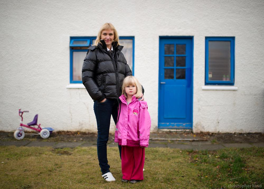 Lísa Björk Ingólfsdóttir with her daughter Lilja outside their home in Kópavogur, Iceland. Lísa lost her job as an accountant after the economic crash in Iceland in 2008.