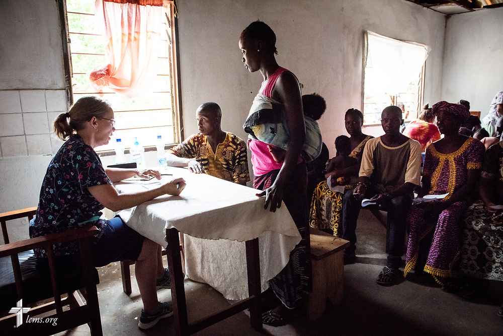 Nurse Donna Mulholland, a member of Shepherd of the Valley Lutheran Church, Fort Bridger, Wyo., sees a new patient on the fifth day of the LCMS Mercy Medical Team on Friday, May 11, 2018, in the Yardu village outside Koidu, Sierra Leone, West Africa. LCMS Communications/Erik M. Lunsford