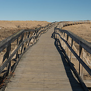 Newbury,MA USA - April 04, 2015. A boardwalk crosses the protected sand dunes of the Parker River National Wildlife Refuge.