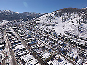 SHOT 3/2/17 11:28:13 AM - Aerial photos of Park City, Utah. Park City lies east of Salt Lake City in the western state of Utah. Framed by the craggy Wasatch Range, it's bordered by the Deer Valley Resort and the huge Park City Mountain Resort, both known for their ski slopes. Utah Olympic Park, to the north, hosted the 2002 Winter Olympics and is now predominantly a training facility. In town, Main Street is lined with buildings built primarily during a 19th-century silver mining boom that have become numerous restaurants, bars and shops. (Photo by Marc Piscotty / © 2017)