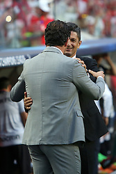 August 21, 2018 - Lisbon, Portugal - Benfica's head coach Rui Vitoria (L) hugs PAOK's head coach Razvan Lucescu from Romania (R ) during the UEFA Champions League play-off first leg match SL Benfica vs PAOK FC at the Luz Stadium in Lisbon, Portugal on August 21, 2018. (Credit Image: © Pedro Fiuza/NurPhoto via ZUMA Press)