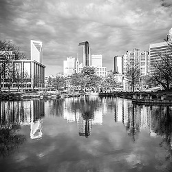 Charlotte skyline reflection on Marshall Park pond with Duke Energy Center and One Wells Fargo Center buildings. Charlotte, North Carolina is a major city in the Eastern United States of America.