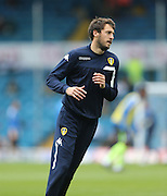 Leeds United midfielder Will Buckley (25) warming up during the Sky Bet Championship match between Leeds United and Brighton and Hove Albion at Elland Road, Leeds, England on 17 October 2015.