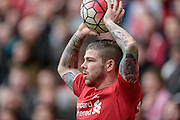 Alberto Moreno (Liverpool) takes a throw-in during the Barclays Premier League match between Liverpool and Stoke City at Anfield, Liverpool, England on 10 April 2016. Photo by Mark P Doherty.