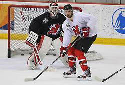 May 29; Newark, NJ, USA; New Jersey Devils center Travis Zajac (19) skates in front of New Jersey Devils goalie Martin Brodeur (30) during Stanley Cup Finals media practice day at the Prudential Center.