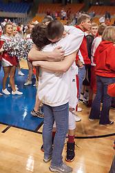 Poca guard Luke Frampton (14) hugs his mom after winning the Class AA championship game at the Charleston Civic Center.