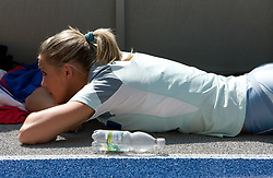 Snezana Rodic  of Slovenia relaxes during the women's triple jump qualifying event of the 2009 IAAF Athletics World Championships on August 15, 2009 in Berlin, Germany. (Photo by Vid Ponikvar / Sportida)
