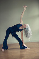 Mature Woman practicing yoga.