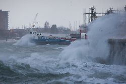 © Licensed to London News Pictures. 23/02/2017. Portsmouth, UK.  The Isle of Wight Hovercraft ventures out of Southsea as strong winds and large waves batter the seafront of Southsea Promenade this morning, 23rd February 2017, as Storm Doris hits Britain. Photo credit: Rob Arnold/LNP