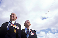 A formation from the Canadian Snowbird demonstration team flies overhead of two decorated Spitfire pilot veterans during a Remembrance day ceremony, remembering Canada's fallen.  Comox, The Comox Valley, Vancouver Island, British Columbia, Canada.