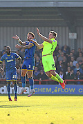 Callum Kennedy of AFC Wimbledon and Hartlepool United striker Rhys Oates jump during the Sky Bet League 2 match between AFC Wimbledon and Hartlepool United at the Cherry Red Records Stadium, Kingston, England on 31 October 2015. Photo by Stuart Butcher.