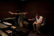 EbGb works with producer Tony Catania on a song for his album Black Light District in the studio at Orange Glow Music, Inc. EbGb has recorded about 60 songs with Orange Glow Music in the past year. His working relationship with Catania during that time has reached a point of mutual respect. On this night they had differing thoughts about the direction of a song they were creating, but Catania convinced EbGb of his idea by showing him a video on youtube for visual inspiration. EbGb has very firm ideas about his music and the direction he wants it to go. It has taken time for him to release some of the control during the creative process. To this date, Orange Glow has invested more than $400,000 in recording costs on EbGb. The producers plan to make a trip to New York with the best songs to pitch Eb to major record labels.