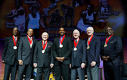 The Class of 2015 from left, Charlie Scott, Ed Ratleff, Lou Henson, Rolando Blackman, Don Donoher,  John Havlicek and Quinn Buckner stand on stage at the conclusion of a National Collegiate Basketball Hall of Fame induction event, Friday, Nov. 20, 2015, in Kansas City, Mo. (AP Photo/Colin E. Braley)