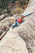 High angle view of a Palan Martin redpointing Ambrosias route, a granite slab in La Pedriza, Madrid