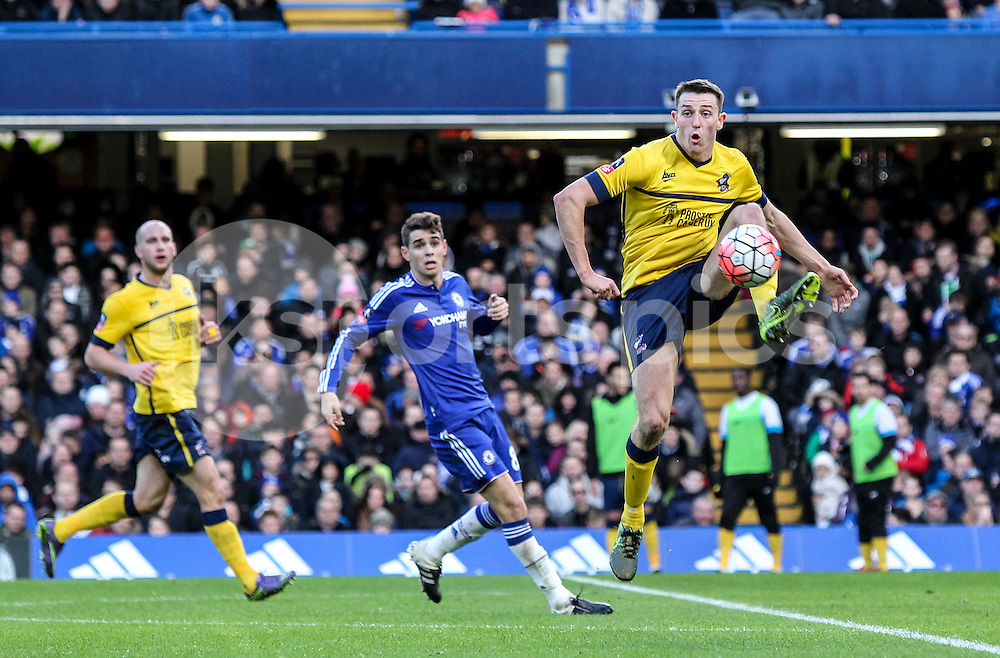 Murray Wallace of Scunthorpe United clears a Chelsea attack during the The FA Cup match between Chelsea and Scunthorpe United at Stamford Bridge, London, England on 10 January 2016. Photo by Ken Sparks.