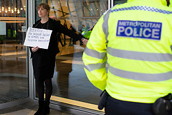 © Licensed to London News Pictures. 14/10/2019. London, UK. An Extinction Rebellion activist glues herself to the BlackRock Offices . Today protesters are targeting the financial district . Photo credit: George Cracknell Wright/LNP