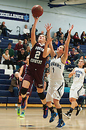 North Country's Carley Giroux (2) leaps past MMU's Ellie Devereux (1) for a lay up during the girls basketball game between the North Country Falcons and the Mount Mansfield Cougars at MMU high school on Monday night February 15, 2016 in Jericho. (BRIAN JENKINS/for the FREE PRESS)