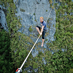 Shane Yates on his first attempt of the Harwoods hole highline. New Zealand.