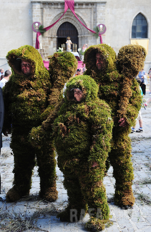 """Three """"Hombres de Musgo"""" (Moss Men) take part in the Corpus Christi procession, on June 6, 2010, in the Spanish village of Bejar, Salamanca province. Legend sais that being Bejar a muslim village, on XII century, a group of christians covered their clothes with moss and attacked the muslim castle. The terrified muslims left the castle and Bejar was conquered by christians. The Moss Men take part in the Corpus Christi procession since 1397. PHOTO/Rafa Rivas"""