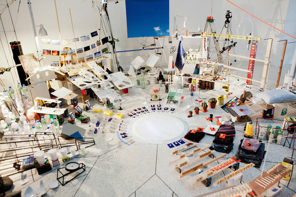 VENICE, ITALY - 1 JUNE 2013: Sarah Sze's &quot;Triple Point (Pendulum)&quot;, 2013 -<br /> Salt, water, stone, string, projector, video, pendulum, mixed media - at the US Pavilion at the Giardini of the Biennale in Venice, Italy, on June 1st 2013. <br /> <br /> Sarah Sze's &quot;Triple Point&quot; comprises a series of interrelated installations that transform the rooms of the United States Pavilion into a chain of immersive experiences. Extending beyond the confines of the gallery spaces to include the building's exterior, entrance, and exit, the exhibition directly engages the Neoclassical building designed in 1930 by architects William Adams Delano and Chester Holmes Aldrich, challenging its Palladian sense of order.<br /> Since the 1990s, artist Sarah Sze (b. 1969) has developed a sculptural aesthetic that<br /> transforms space through radical shifts in scale, colonizing overlooked or peripheral spaces, engaging with the fabric and history of a building, and shifting the viewer's perception and<br /> experience of architecture through large-scale, site-specific interventions. Triple Point brings together many of the ideas that Sze has developed during her practice.<br /> ?Central to the exhibition is the notion of the ?compass? and how we locate ourselves in a perpetually disorienting world.&quot; said Sze.<br /> <br /> The 55th International Art Exhibition of the Venice Biennale takes place in Venice from June 1st to November 24th, 2013 at the Giardini and at the Arsenale as well as in various venues the city. <br /> <br /> Gianni Cipriano for The New York TImes