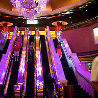 Visitors descend the escalator in the Trump Taj Mahal casino in Atlantic City, NJ on September 4, 2014.  Thousands of casino workers out of work due to the closure of 4 casinos.